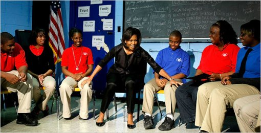 Michelle Obama talks to a small group of students at Anacostia High School in Washington
